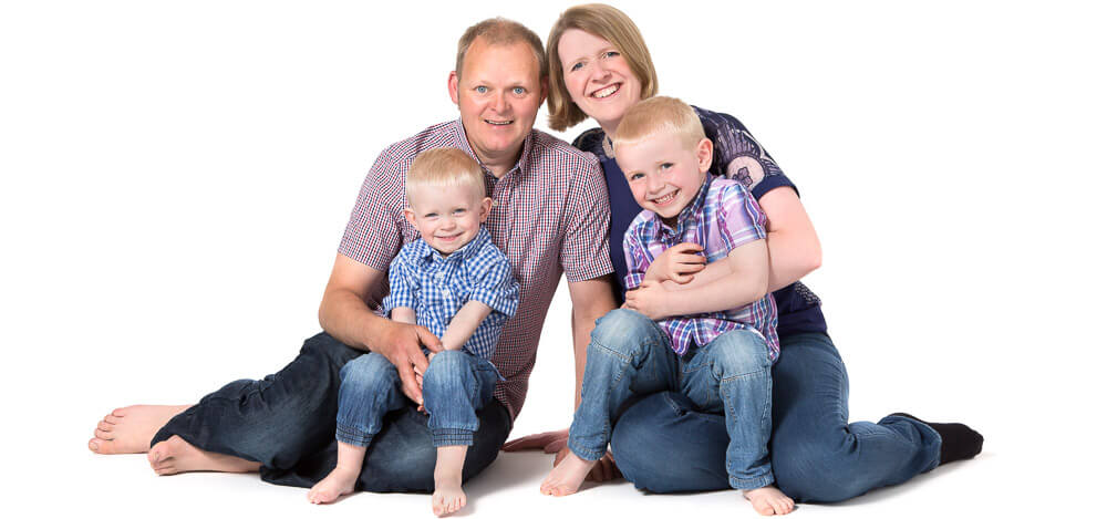 Family Portraits of a Mum, Dad and their Two Sons on a White Background in Thame, Oxfordshire
