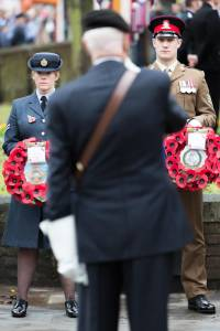 RAF and Army hold poppy wreaths at the High Wycombe Remembrance Parade