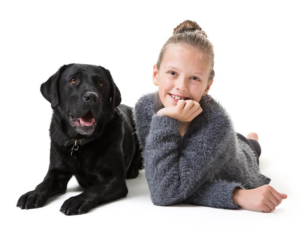 Portrait of a girl and her black labrador in Thame, Oxfordshire
